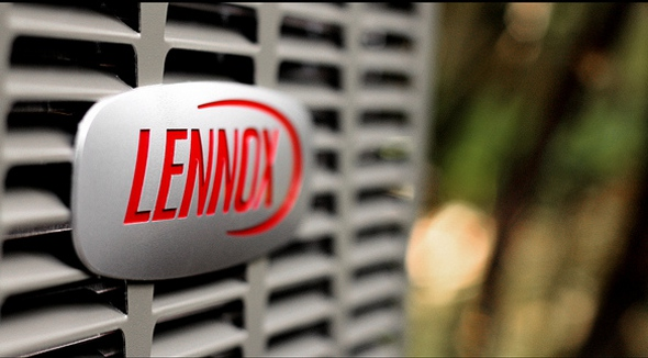 lennox logo on an air conditioning unit up close